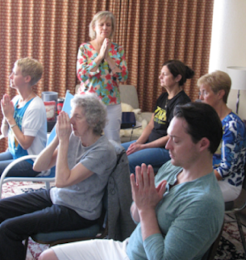 students in one of Kumari's Reiki certification classes