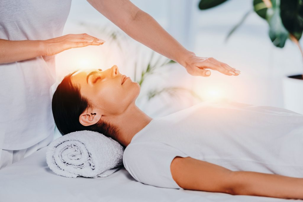 reiki energy healing on woman laying down, free global energy healing and guided meditation
